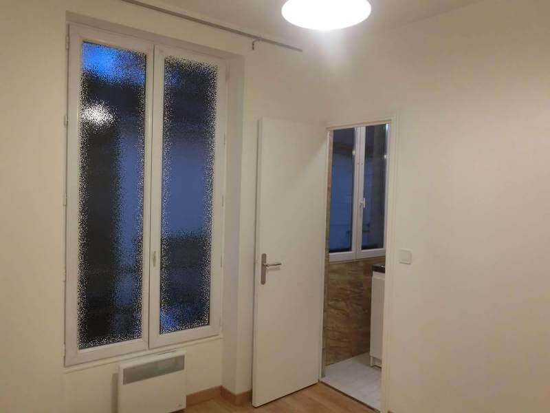 The kitchen is on the right of the image